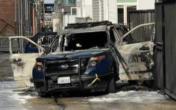 Seattle police vehicle set on fire with officer inside, accused man arrested